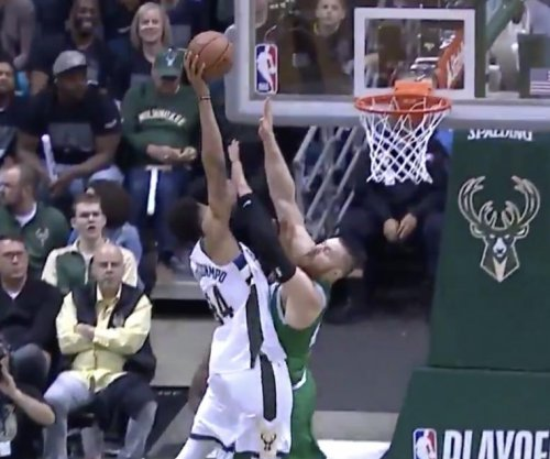 Giannis Antetokounmpo puts Aron Baynes on poster with dunk