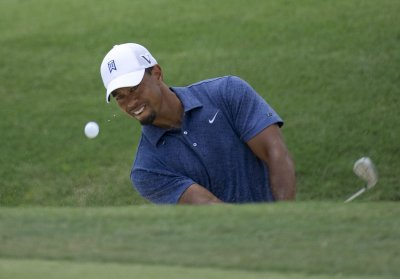 Woods earns first victory since scandal