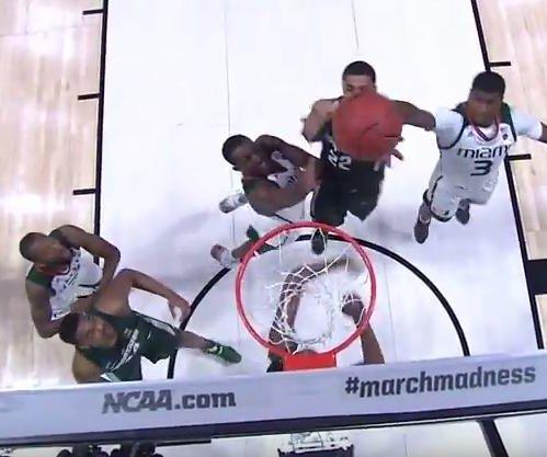NCAA: Michigan State drills Miami
