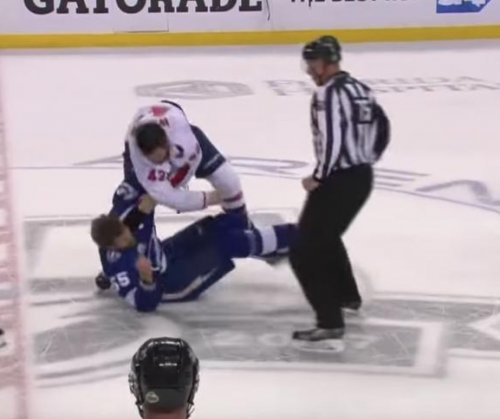 Caps' Wilson bloodies knuckles in fight with Lightning's Coburn