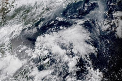 Developing tropical system looms for flood-weary South Korea, Japan