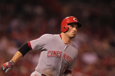 Joey Votto powers Cincinnati Reds past Chicago Cubs
