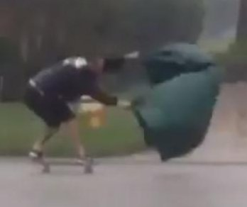 Florida man goes land sailing with skateboard and tarp in Hurricane Matthew