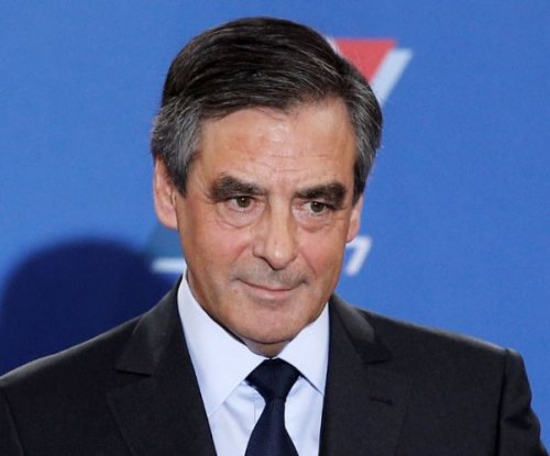 French presidential candidate Fillon to continue campaign despite wife-job scandal