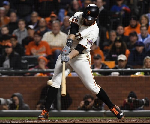 San Francisco Giants: Brandon Belt takes pitch to helmet
