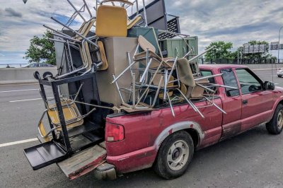 Police stop pickup truck overloaded with desks, chairs