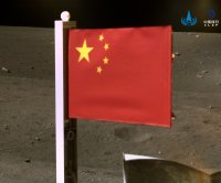 China unfurls its first fabric flag on moon