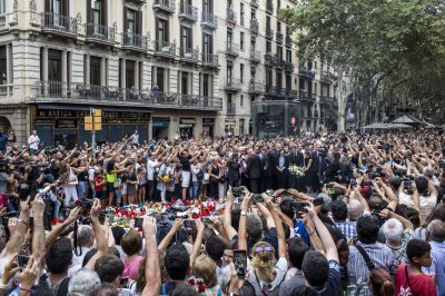 Barcelona mourns as search continues for new suspect
