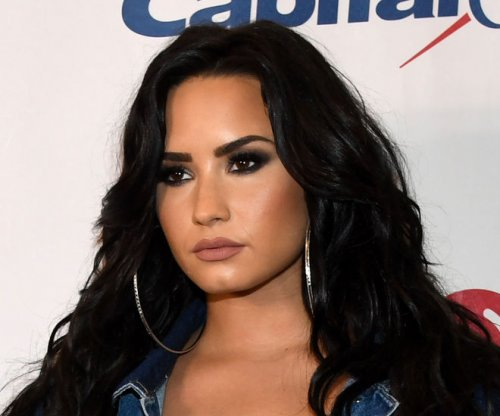 Demi Lovato says swimsuit photos show new-found 'self-love'