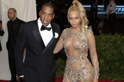 Beyonce, Jay-Z helped drive record attendance at the Louvre