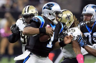 Carolina Panthers' Ron Rivera keeps calm after hits on Cam Newton