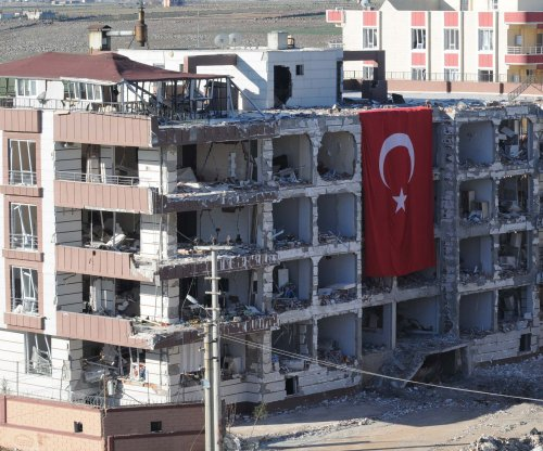 Child killed in Turkey car bomb, 26 suspects detained