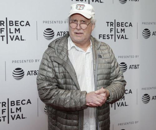 Chevy Chase kicked in shoulder during road rage clash, police say