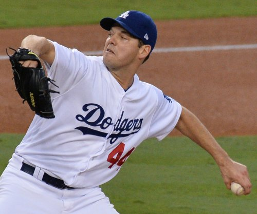 Dodgers try to avoid getting swept by Reds