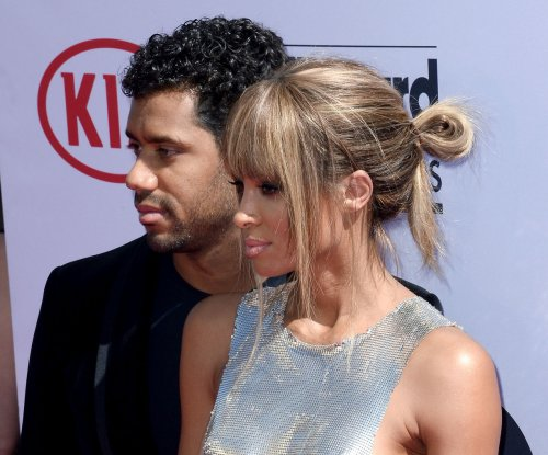 Football player Russell Wilson proves to fiancee Ciara he's not a singer