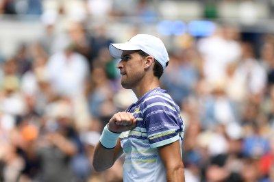Australian Open: Federer and Halep cruise; Thiem wins 5-set marathon