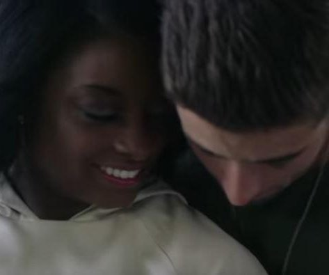 Simone Biles stars in Jake Miller's music video for 'Overnight'