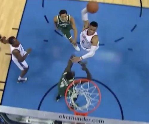 Oklahoma City Thunder's Russell Westbrook posterizes Milwaukee Bucks' Thon Maker