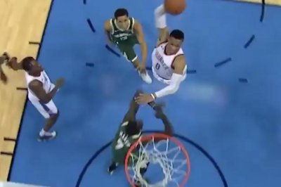 Oklahoma City Thunder's Russell Westbrook posterizes Milwaukee Bucks' Thon Maker