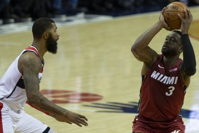 Wade, Heat return to Chicago
