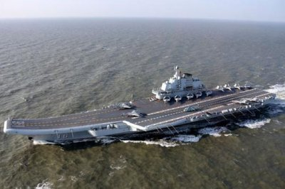 Chinese aircraft carrier sails past Japan, Taiwan