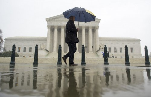 Supreme Court limits, does not forbid union contributions