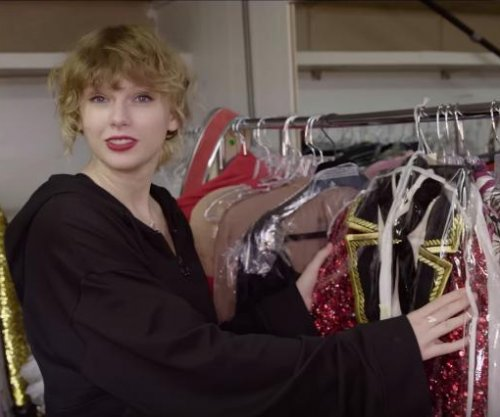 Taylor Swift gives behind-the-scenes look at music video wardrobe