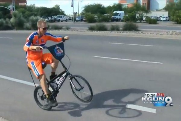 Watch: Man attempts to cycle cross-country while wheelieing