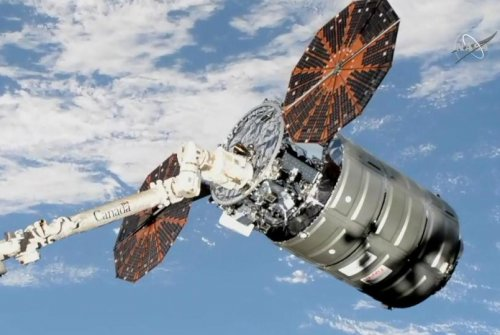 Robotic arm links cargo craft to International Space Station