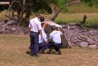 Wing piece, suitcase will take days to link to MH370