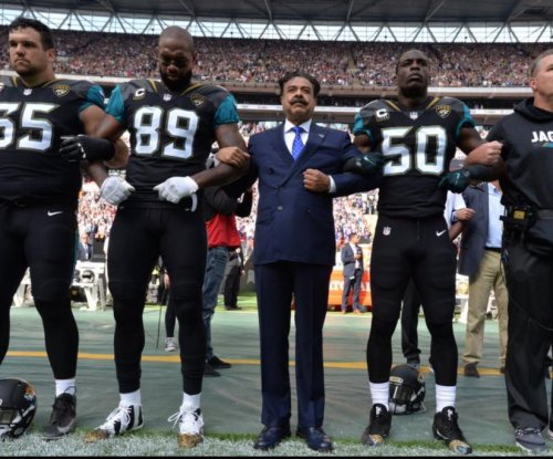 Shahid Kahn: Jacksonville Jaguars owner joins team during national anthem protest