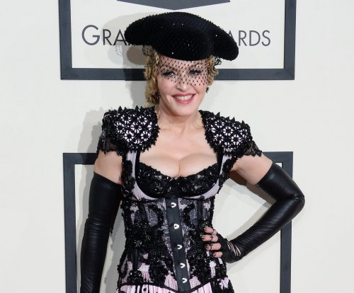 Madonna stuns in sexy ensemble on the red carpet at the Grammys