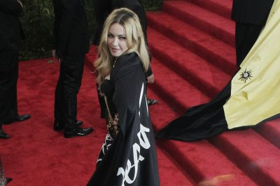 Madonna stumps for Hillary Clinton in surprise New York rally