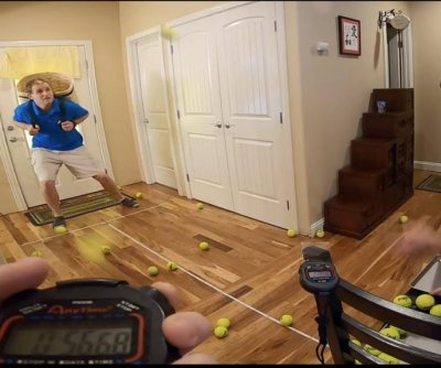 Idaho friends break Guinness record for tennis ball catches in a basket