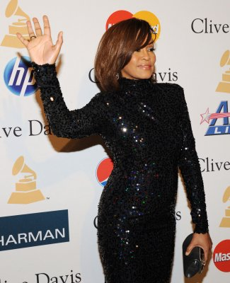 Whitney Houston causes scene on airplane