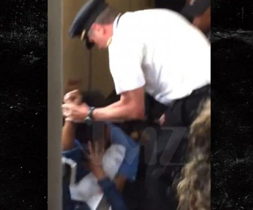 Delta pilot cleared after striking female during passenger fight
