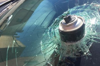 Hairspray can explodes in hot car, embeds itself in windshield