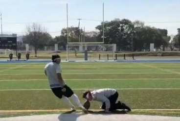 High school kicker makes deep field goal while blindfolded