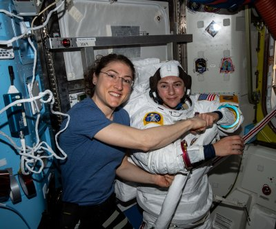 Watch live: Meir, Koch extend outside space station for all-female spacewalk