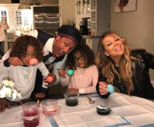 Mariah Carey, Nick Cannon and twins pose for family Easter photo
