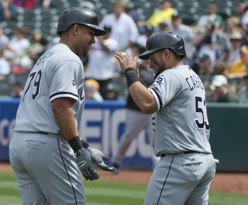 Mat Latos, Chicago White Sox shut down Oakland Athletics to take series