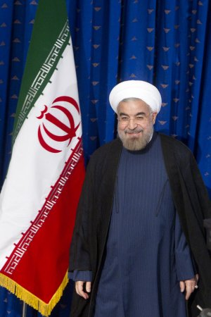 Iran can take the heat, Rouhani says