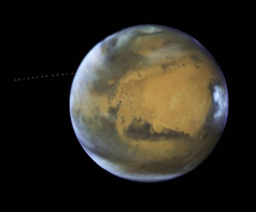 Hubble spots Phobos orbiting Mars