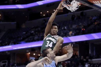 Giannis Antetokounmpo jumps on Marc Gasol's back for big dunk