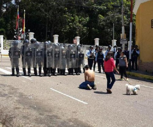 Venezuelan teenager killed during protest; President Maduro orders investigation