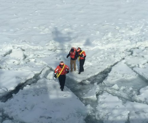 Coast Guard rescues man trying to walk across frozen lake