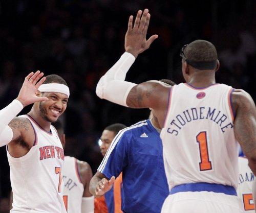 Miami Heat sign Stoudemire, re-sign Wade