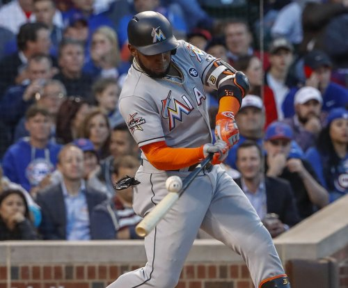 Marcell Ozuna, Miami Marlins mash Milwaukee Brewers