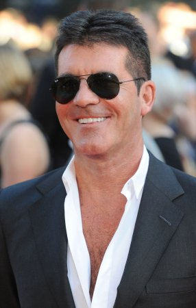 Simon Cowell, expectant dad, says he is 'happier than I've ever been'
