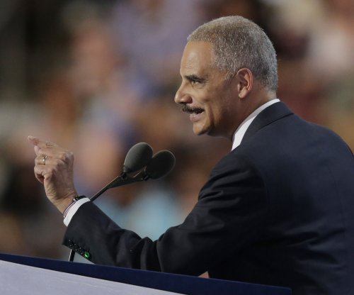 Eric Holder says Clinton will work to end 'systemic racism'